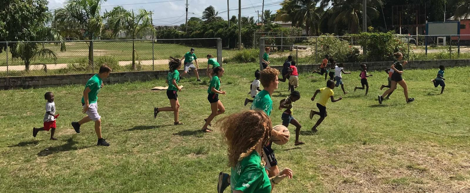 Projects Abroad Sports Coaching volunteers play sports games with children in Belize
